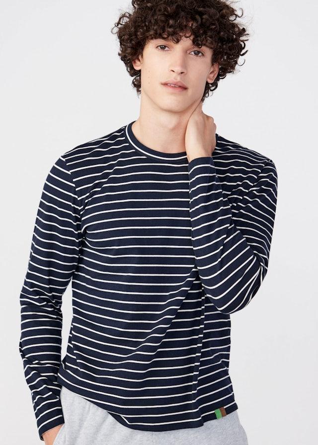 KULE Green - Male model wearing the navy Rufus Organic tee.