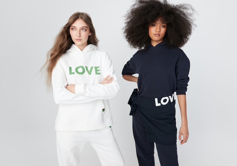 KULE- Two models wearing LOVE Sweatshirts. One in Navy and one in White.