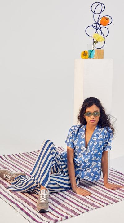 KULE- Model wearing The Tina blue hawaiian button down and The Saffron lounge pants.