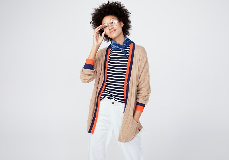 KULE- Model wearing The Moden Long in Navy/Cream and The Sinclair cardigan in Camel.