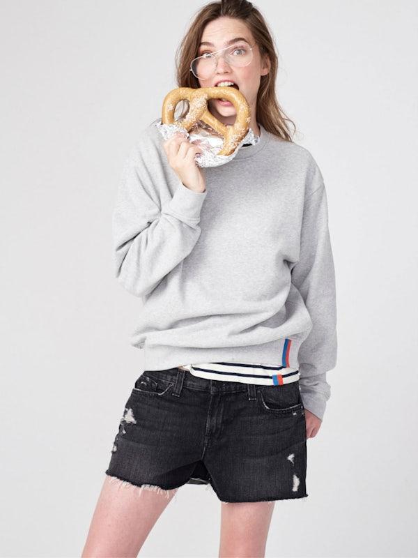 KULE- Model eating a soft pretzle making a funny face